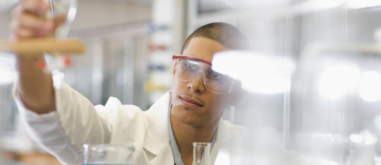 male student working in chemistry lab